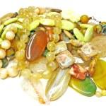 Heap of yellow semiprecious beads — Stock Photo