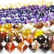 Backgound of colorful semiprecious beads — Stock Photo #9923714