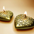 Bronze candles set heart shape — Stock Photo