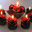 Foto Stock: Rose spscented candles set in darkness