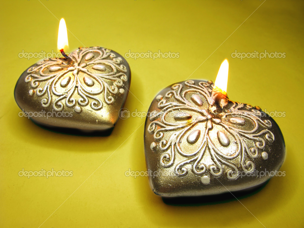 Set of heart scented candles as present on dark background  Stock Photo #9941422