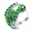 Jewelry ring with bright green emerald crystals - Stock Photo
