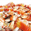 Heap of red semiprecious beads — Stock Photo #9992185