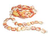 Högen av röda semigem jasper pärlor — Stockfoto