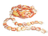 Heap of red semigem jasper beads — Стоковое фото