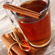 Stock Photo: Glass and cinnamon drink