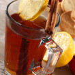 Stock Photo: Tein glass and lemon and cinnamon