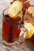 Tea in glass and lemon and cinnamon — Stock Photo