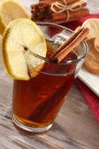 Tea in glass and lemon and cinnamon — Stock Photo