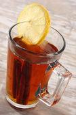 Tea in glass and lemon — Stock Photo