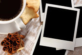 Photo and coffee on desk — Stock Photo