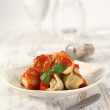 Ravioli on table and glasses — Stockfoto