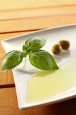 Oil and basil — Stock Photo