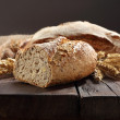 Bread on old wooden table — Stock fotografie