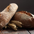 Stock Photo: Bread on old wooden table