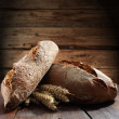 Bread on old wooden table — Foto de stock #10531631