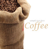 Coffee beans in sack — Stockfoto