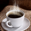 White cup of coffee on brown color — Foto Stock
