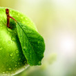Green apple in garden — Stock Photo