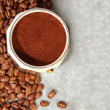 Coffee on silver background and beans — Stok fotoğraf