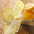 Stock Photo: Cold water in glass and lemon