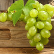 Grapes in box on desk — Stock Photo