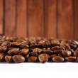 Stock Photo: Coffee beans on wooden background