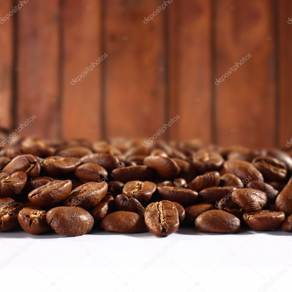 Photo of coffee beans on wooden background  — Stock Photo #9831365