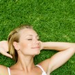 Stock Photo: Beautiful Healthy Young WomLying On Green Grass
