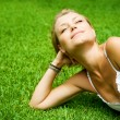 Beautiful Healthy Young Woman Lying On The Green Grass — Stock Photo #10603817