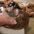 Spa. Handsome Man With A Mud Mask On His Face — Stock Photo