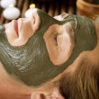 Spa. Handsome Man With A Mud Mask On His Face — Stock Photo #10604935