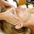 Spa. Young Man Getting Face Massage — Stock Photo