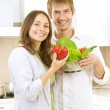 Young Couple Cooking Healthy food.Diet.Kitchen — Stock Photo