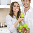 Photo: Couple eating fresh fruits.Healthy food.Diet.Kitchen
