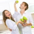 Happy Couple Eating fresh fruits.Having fun on a kitchen.Dieting — Stock Photo