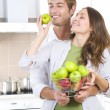 Foto de Stock  : Lovely Sweet Couple eating fresh fruits.Healthy food.Diet