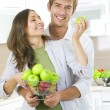 Couple eating fresh fruits.Healthy food.Diet.Kitchen — Stock Photo #10605106