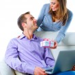 Happy couple with gift.Happy woman giving a gift to her husband. — Stockfoto