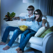 Foto Stock: Family watching 3D film on TV