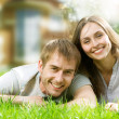 Stock Photo: Happy Couple near their House. Smiling Family outdoor. Real Esta