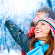 Foto Stock: Happy Young Couple in Winter Park having fun.Family Outdoors