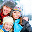 Stock Photo: Family Outdoors.Happy Family with kid blowing Snow.Winter