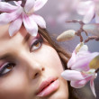 Beautiful Girl's face with flowers — Stock Photo