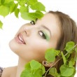 Beautiful Woman With Green Leaves. Natural Beauty. Healthy Skin — Stock Photo #10605396