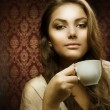 Beautiful Woman with cup of coffee — Stock Photo