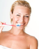 Happy Young Woman Brushing Her Teeth — Stock Photo