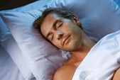 Young Man Sleeping In His Bed — Stock Photo