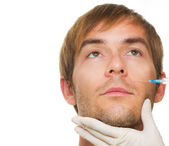 Man gets cosmetic injection of botox .Beauty Treatment — Stock Photo