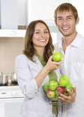 Couple eating fresh fruits.Healthy food.Diet.Kitchen — Stock Photo